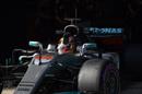 Lewis Hamilton waves his hand