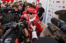 Kimi Raikkonen talks with media