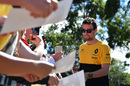 Jolyon Palmer signs autographs for the fans
