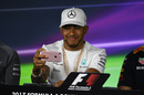 Lewis Hamilton takes a photograph on his iPhone