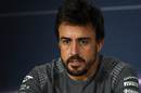 Fernando Alonso talks to the media in the press conference