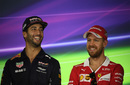 Daniel Ricciardo and Sebastian Vettel smile in the press conference