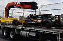 Jolyon Palmer's Renault is recovered after crashing in FP2