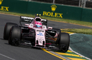 Esteban Ocon rides the kerb in his Force India