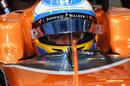 Fernando Alonso sits in the McLaren cockpit