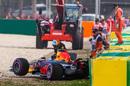 Daniel Ricciardo leaves his car after crashed in Q3