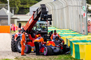 Daniel Ricciardo's Red Bull is recovered by the marshals after crashing in Q3