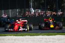Sebastian Vettel leads Max Verstappen