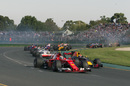 Kimi Raikkonen and Max Verstappen battle for a position at the start of the race