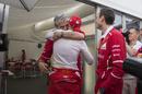 Maurizio Arrivabene and Sebastian Vettel hug after the race