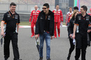 Esteban Ocon walks the track with his engineers