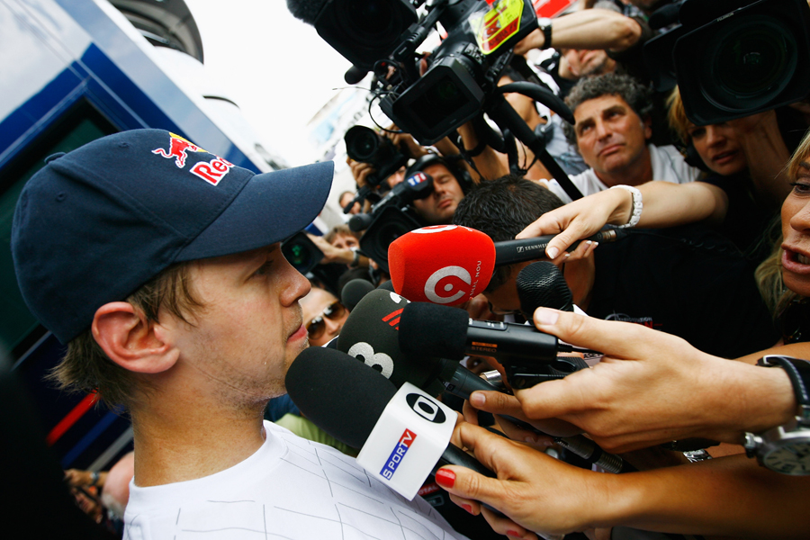 Sebastian Vettel faces the media hoards as the race goes on