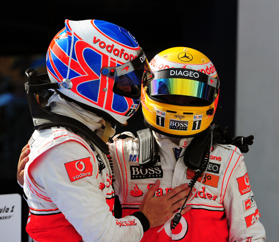 Jenson Button congratulates race winner Lewis Hamilton after a McLaren 1-2