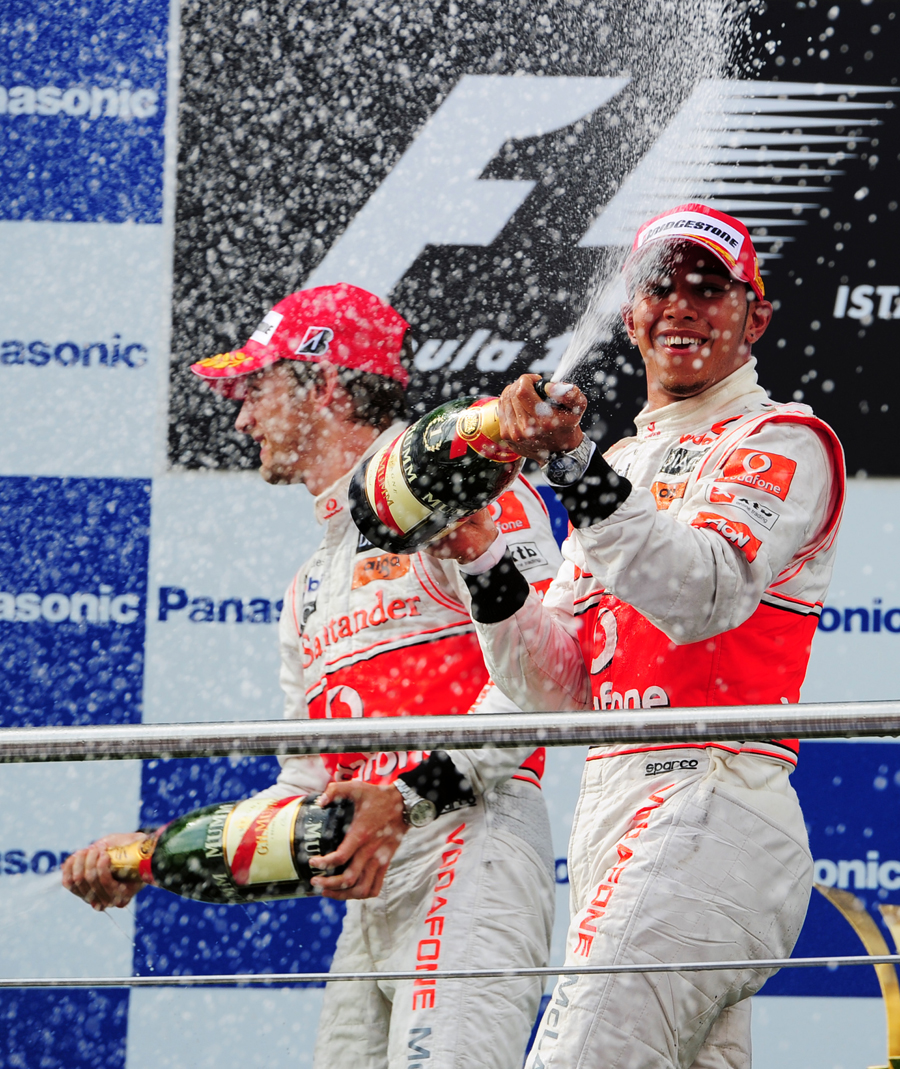 The champagne flies after the McLaren 1-2