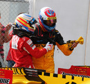 Fernando Alonso and Vitaly Petrov discuss their minor collision after the race