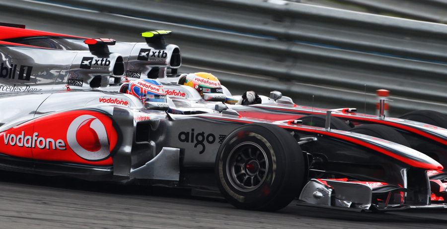 Jenson Button and Lewis Hamilton battle it out - '