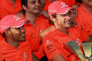 Jenson Button and Lewis Hamilton celebrate with the McLaren team