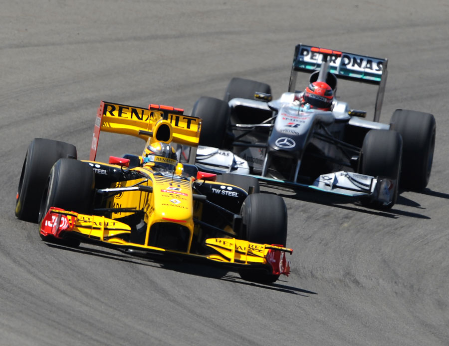 Robert Kubica leads Michael Schumacher on track