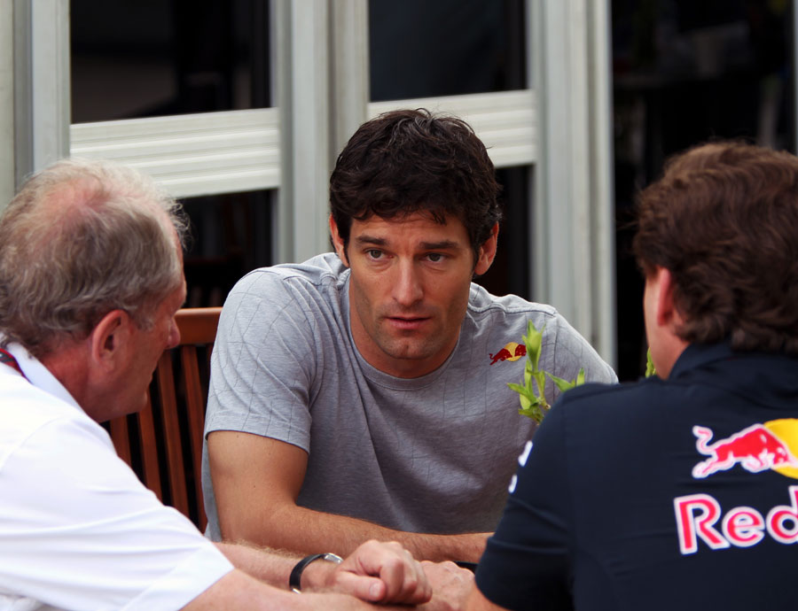 Mark Webber, Christian Horner and Helmut Marko chat in the paddock