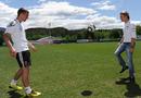 Nico Rosberg shows off his ball skills with German footballer Lukas Podolski