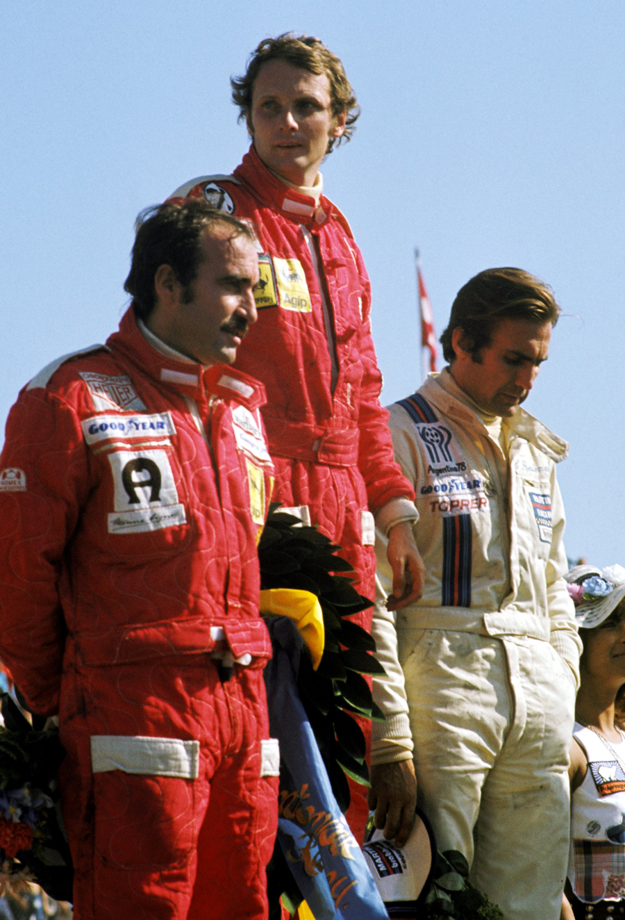 The podium at the Swedish Grand Prix - Clay Regazzoni, who finished third, race winner Niki Lauda and second-placed Carlos Reutemann