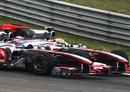 Lewis Hamilton fights back against Jenson Button for the lead