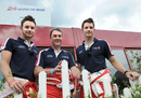 Nigel Mansell poses for a photo with his sons Greg and Leo
