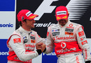 Jenson Button congratulates Lewis Hamilton on the podium