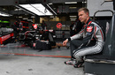 Kevin Magnussen waits the session start in the garage