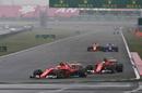 Kimi Raikkonen leads his teammate Sebastian Vettel
