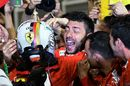 Sebastian Vettel cerebrates with Ferrari