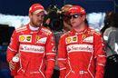 Pole sitter Sebastian Vettel and Kimi Raikkonen in parc ferme