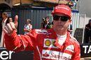 Pole sitter Kimi Raikkonen celebrates in parc ferme