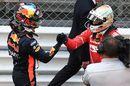 Sebastian Vettel and Daniel Ricciardo celebrate in parc ferme
