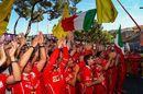 Ferrari team mechanics celebrate in parc ferme