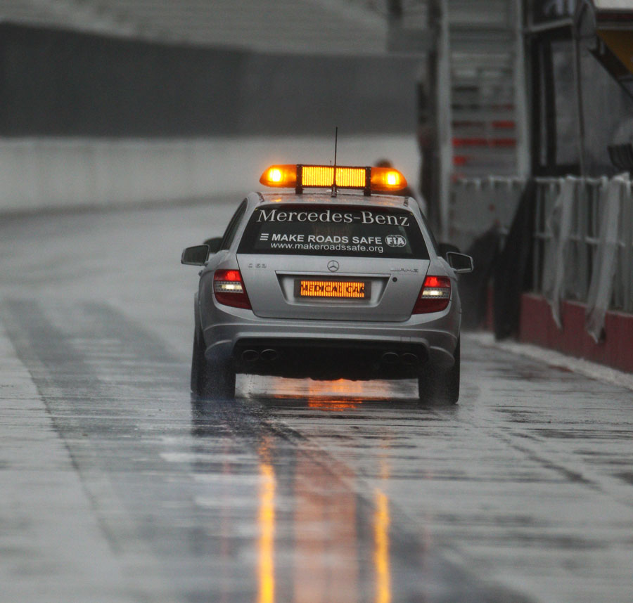 A safety car laps a soaking Circuit Gilles Villeneuve on Thursday