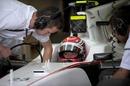 Sauber driver Kamui Kobayashi in the pits