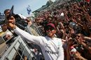 Race winner Lewis Hamilton celebrates with the fans