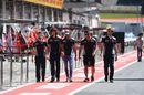 Carlos Sainz jr walks the pit lane
