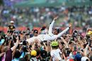 Race winner Lewis Hamilton celebrates with the fans and crowdsurfs