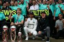 Lewis Hamilton celebrates with his trophies alongside Valtteri Bottas, his brother Nick Hamilton, Billy Monger and the team