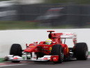 Felipe Massa peers out of his cockpit as he narrowly misses the wall