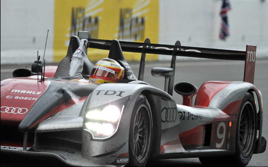 German driver Timo Bernhard crosses the line in the number nine Audi R15 TDI to win the Le Mans 24-hour race