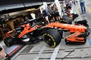 Fernando Alonso pulls out of the McLaren garage with halo