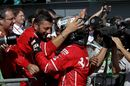 Sebastian Vettel celebrates in parc ferme with the team