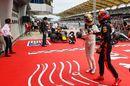 Race winner Max Verstappen and Lewis Hamilton celebrate in parc ferme
