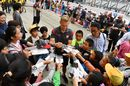 Kevin Magnussen signs autographs for the fans