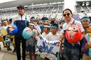 Lance Stroll and Felipe Massa with young Williams fans