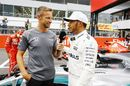 Pole sitter Lewis Hamilton talks with Jenson Button in parc ferme