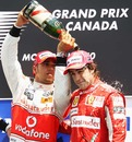 Lewis Hamilton douses Fernando Alonso in champagne